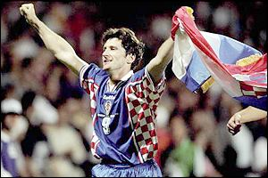 Davor Suker proudly clasps Croatia's flag after his side's 3-0 win over Germany. Suker finished the tournament as top goalscorer