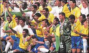 The Brazilian team pose with the trophy after beating Italy on penalties in the World Cup final at the Rose Bowl in Los Angeles