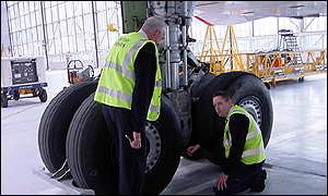 Concorde's specially reinforced tyres are checked by engineers