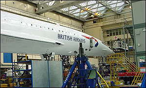 Last minute work is carried out at Heathrow ahead of the first commercial flight
