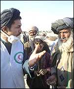 Red Crescent worker talks to Afghan refugees