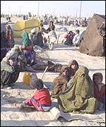 refugees at the squalid refugee camp of Makaki, run by the Iranian Red Crescent