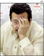 Joseph Estrada covers one eye with his hand - he has an infection