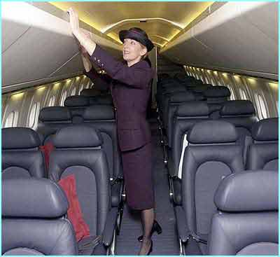 A stewardess checks the newly designed Concorde cabin