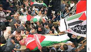 Palestinian mourners at the funeral of three men who were killed in the West Bank