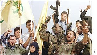 Hezbollah guerrillas and supporters celebrate Israeli withdrawal