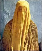 A woman dressed in a burqa