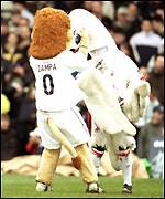 Swansea's Cyril the Swan clashes with Millwall's Zampa the Lion