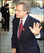 Henry McLeish waves to the media as he arrives to make his resignation statement at the Scottish Parliament