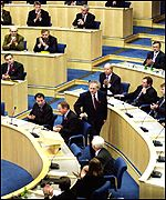 Henry McLeish takes his seat in the Scottish Parliament