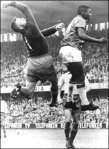 Swedish goalkeeper Kalle Svensson struggles to contain rising star Pele in the final