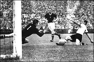 Max Morlock scores the opening goal for Germany in their 3-2 victory over Hungary in the final
