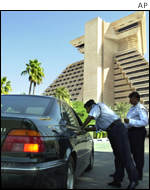 Qatari police check a car in front of the Sheraton Hotel in Doha, Qatar