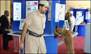 Policeman and his dog check Doha's Sheraton hotel