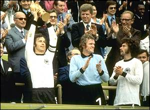 Franz Beckenbauer lifts the new World Cup trophy aloft as goalkeeper Sepp Maier applauds his skipper