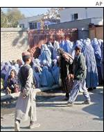 Women queuing outside Saudi Afghan food store