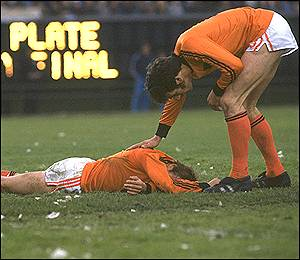 Dutch players console each other after losing the final