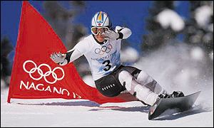Ross Rebagliati carves past a marker flag on his way to slalom gold in Nagano