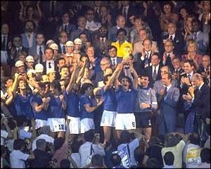 King Juan Carlos of Spain presents the Italian team with the World Cup