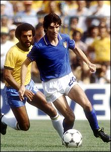 Italy's Paolo Rossi guards possession against Junior of Brazil