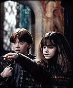 Rupert Grint and Emma Watson as Ron and Hermione