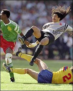 Rene Higuita is upended by a one of his own defenders as he charges out of his penalty area