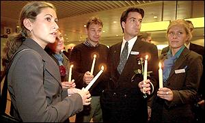 Sabena employees hold candles