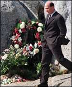 [ image: Swissair Chief Executive Jeffrey Katz walks past a memorial at the site]