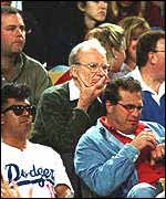 Murdoch watching one of his aquisitions - the Dodgers baseball team