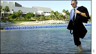 A delegate takes time out to paddle near a conference hotel