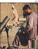 Opposition soldier prepares a mortar