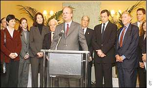 President Bush's political advisor Karl Rove, centre, surrounded by Hollywood executives