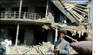 Kabul resident next to the ruins of his home