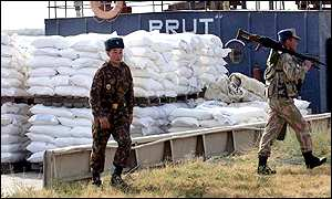Uzbek soldiers guard UN aid destined for Afghanistan in the city of Termez, Uzbekistan