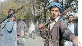 Northern Alliance fighters patrol the streets of Kabul