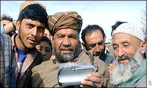 Kabul residents listen to music tape