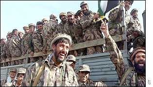 Jubilant Northern Alliance fighters at the front-line village of Rabat near Bagram, 50 kilometres (30 miles) from Kabul