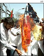 Taleban supporters burn a US flag in Pakistan