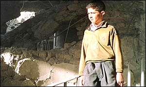 Afghan boy in the ruins of the al-Jazeera office