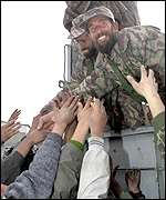 Northern Alliance soldiers are greeted by Kabul residents