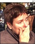 A Queens resident cries near the crash scene