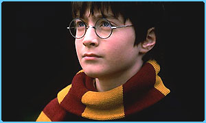 Daniel Radcliffe as Harry Potter wearing his Gryffindor scarf