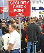 Passengers at Chicago's O'Hare airport queue at checkpoint