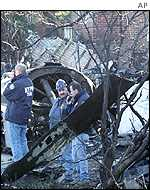 Emergency workers examine wreckage from the crash