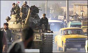 Northern Alliance forces on a tank in the streets of Kabul