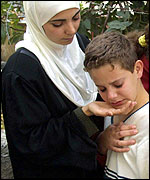 Boy crying with unidentified woman
