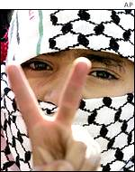 A Palestinian boy flashes a victory sign