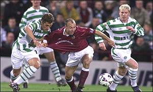 Petrov and Lennon look on for Celtic