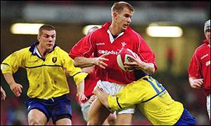 Dafydd James is tackled by Christian Lupu of Romania