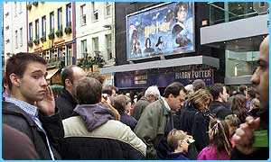 Fans queue outside cinemas on the day Harry Potter and the Philiosopher's Stone in released